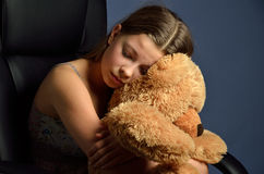 Teenage girl with a teddy bear Royalty Free Stock Image