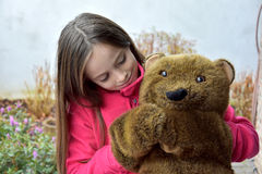 Teenage girl with teddy bear Royalty Free Stock Images