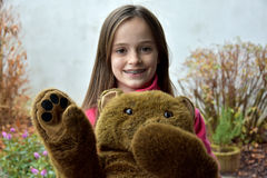 Teenage girl with teddy bear Stock Photos