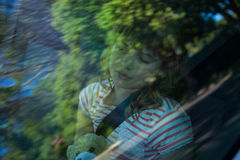 Teenage girl with teddy bear sleeping in the back seat of car. Cute teenage girl with teddy bear sleeping in the back seat of car Royalty Free Stock Photo