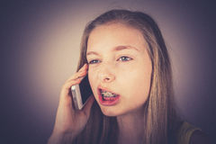 Teenage girl telephoned indignantly, grain effect Royalty Free Stock Photos