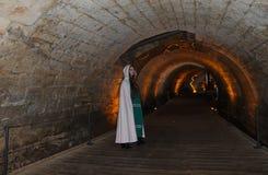 A teenage girl in the Templars tunnel in Akko, Israel. A beautiful teenage girl dressed as a Templar in the Templars Tunnel in Akko, Israel stock photo