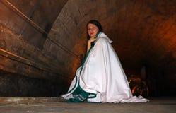 A teenage girl in the Templars tunnel in Akko, Israel. A beautiful teenage girl dressed as a Templar in the Templars Tunnel in Akko, Israel royalty free stock photos