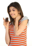 Teenage girl tempted with the cake Stock Images