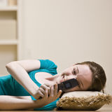 Teenage girl text messaging on cell phone Stock Photos