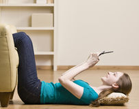Teenage girl text messaging on cell phone Royalty Free Stock Photos
