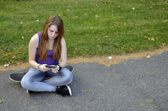 Teenage Girl Texting Stock Photo