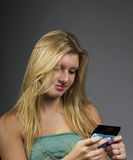 Teenage girl texting Stock Photography