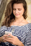 Teenage girl texting message Royalty Free Stock Photo