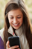 Teenage Girl Texting On Smartphone Stock Photos