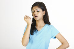 Teenage girl with thermometer royalty free stock images