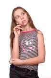 Teenage girl thinking isolated on white Stock Photo