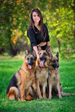Teenage girl with three dogs Royalty Free Stock Photos