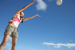 Teenage girl throwing ball Royalty Free Stock Photos