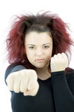 Teenage girl throwing punch Royalty Free Stock Photography