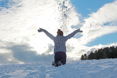 Teenage girl throwing snow Royalty Free Stock Photo