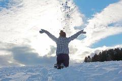 Teenage girl throwing snow