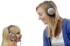 Teenage girl and toddler listen music Royalty Free Stock Photo