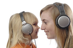 Teenage girl and toddler listen music stock photo