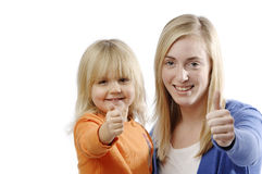 Teenage girl and toddler playing Royalty Free Stock Photo