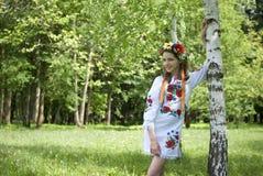 Teenage girl in traditional Ukrainian costume Stock Image