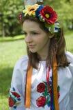 Teenage girl in traditional Ukrainian costume Stock Photos