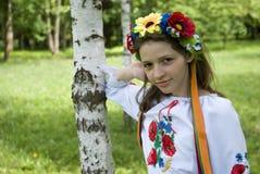Teenage girl in traditional Ukrainian costume Stock Images