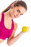 Teenage girl trains with dumbbell Stock Photography