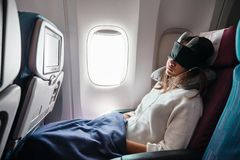 Teenage girl travelling by airplane royalty free stock images