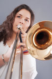Teenage girl with trombone Stock Images
