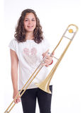 Teenage girl with trombone Stock Images