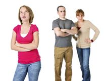 Teenage girl in trouble with parents. Teenage girl rolling her eyes in front of angry parents Stock Photo