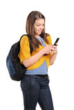 Teenage girl typing a text message on cellphone. Isolated on white background stock photo