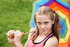 Teenage girl with umbrella Royalty Free Stock Image
