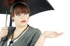 Teenage girl with umbrella Stock Images