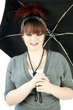Teenage girl with umbrella Stock Images