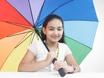 Teenage girl with an umbrella Stock Photos