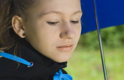 Teenage girl under umbrella Royalty Free Stock Image