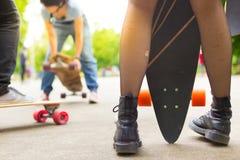 Teenage girl urban long board riding. Stock Image