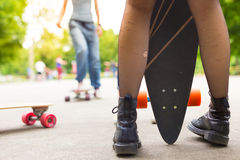 Teenage girl urban long board riding. Royalty Free Stock Photo