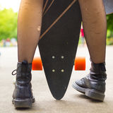Teenage girl urban long board riding. Stock Images