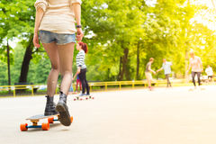 Teenage girl urban long board riding. Royalty Free Stock Images