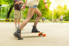 Teenage girl urban long board riding. Royalty Free Stock Photos