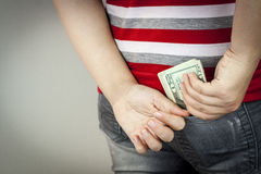 Teenage girl with US dollars Royalty Free Stock Photos