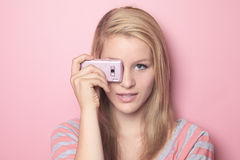 Teenage girl use cellphone in her room Royalty Free Stock Photos