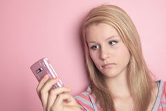 Teenage girl use cellphone in her room Stock Images
