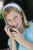 Teenage Girl Using Cell Phone Stock Photo