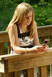 Teenage girl using cell phone. Teenage girl using a cell phone t send a text Royalty Free Stock Photography