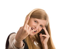 Teenage girl using cell phone gesturing Stock Image
