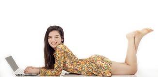 Teenage girl using computer Stock Image